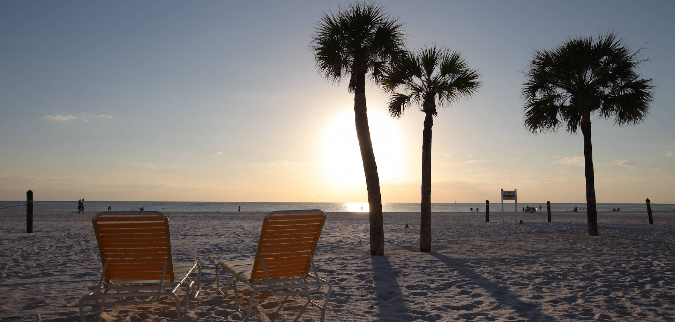 lounge chairs on beach in Siesta Key